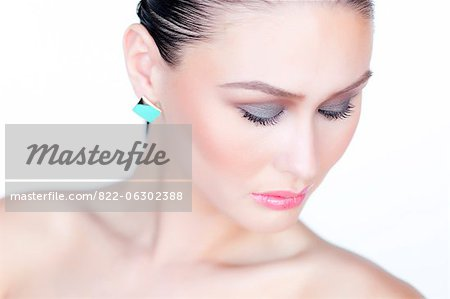 Portrait of Woman Wearing Gold Enamel Earring Stock Photo - Rights-Managed, Image code: 822-06302388