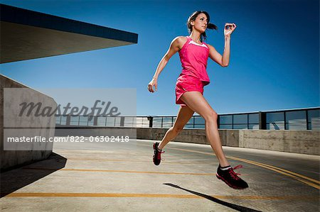 Young Woman Running Outdoors Stock Photo - Rights-Managed, Image code: 822-06302418