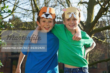 Two Smiling Boys Wearing Animal Masks on Forehead Stock Photo - Rights-Managed, Image code: 822-06302420