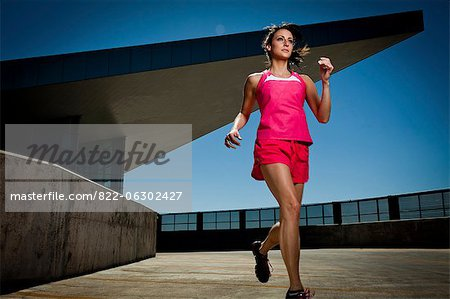 Young Woman Running Outdoors Stock Photo - Rights-Managed, Image code: 822-06302427