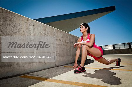 Young Woman Stretching Outdoors Stock Photo - Rights-Managed, Image code: 822-06302428