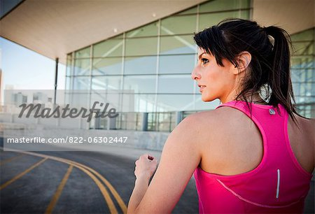 Back View of Young Woman Running Outdoors Stock Photo - Rights-Managed, Image code: 822-06302447