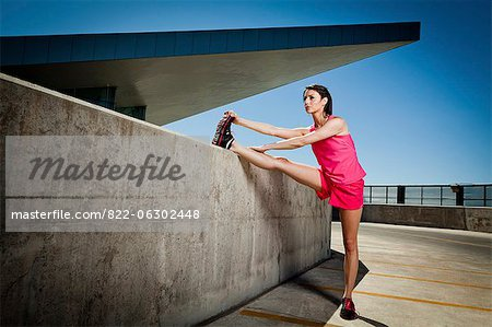 Young Woman Stretching Outdoors Stock Photo - Rights-Managed, Image code: 822-06302448