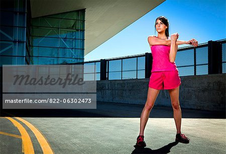 Young Woman Stretching Outdoors Stock Photo - Rights-Managed, Image code: 822-06302473