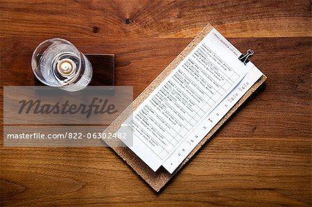 Menu and Candleholder on Wooden Table Stock Photo - Rights-Managed, Image code: 822-06302482