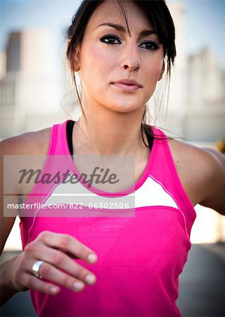 Close up of Young Woman Running Outdoors Stock Photo - Rights-Managed, Image code: 822-06302506