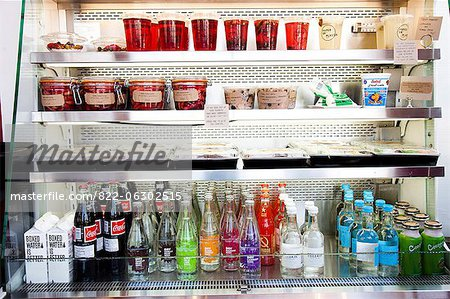 Shop Refrigerator Shelves Stacked with Food Containers and Soft Drink Bottles Stock Photo - Rights-Managed, Image code: 822-06302515