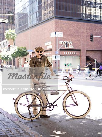 Man with Bicycle Smoking Pipe Stock Photo - Rights-Managed, Image code: 822-06302525
