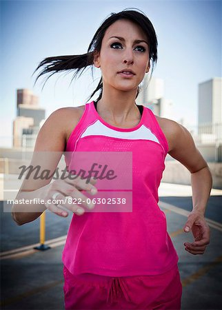 Young Woman Running Outdoors Stock Photo - Rights-Managed, Image code: 822-06302538