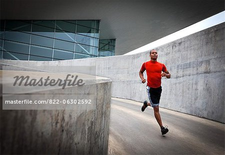 Man Running Outdoors Stock Photo - Rights-Managed, Image code: 822-06302592