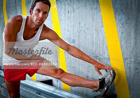 Sportsman Stretching his Leg Stock Photo - Rights-Managed, Image code: 822-06302604