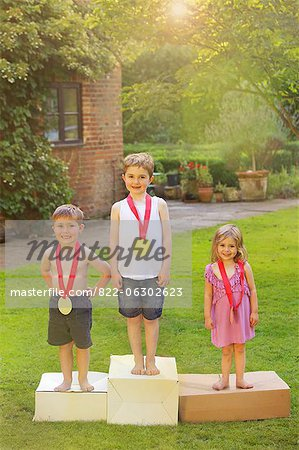 Children Standing on Cardboard Podium with Medals Stock Photo - Rights-Managed, Image code: 822-06302623