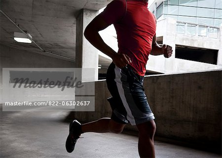 Man Running Outdoors Stock Photo - Rights-Managed, Image code: 822-06302637