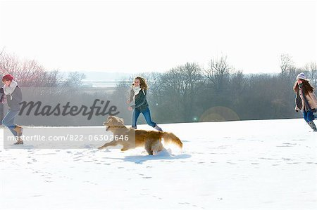 Teenage Girls and Dog Running in Snow Stock Photo - Rights-Managed, Image code: 822-06302646