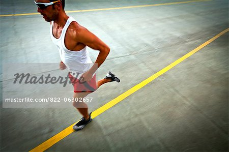 Man Running on Urban Road Stock Photo - Rights-Managed, Image code: 822-06302657