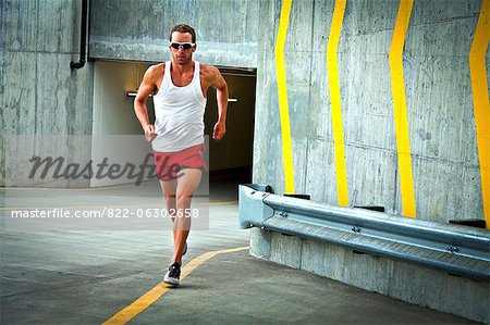 Man Running on Urban Road Stock Photo - Rights-Managed, Image code: 822-06302658