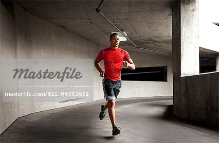 Man Running Outdoors Stock Photo - Rights-Managed, Image code: 822-06302661