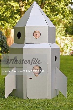 Two Boys Looking Out from Window of Cardboard Rocket Spacecraft Stock Photo - Rights-Managed, Image code: 822-06302668
