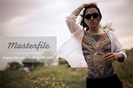 Portrait of Tattooed Man Outdoors Stock Photo - Rights-Managed, Image code: 822-06302692
