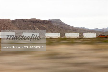 Mountain Landscape and Freight Train, Blurred Motion Stock Photo - Rights-Managed, Image code: 822-06302718