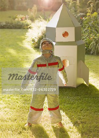Boy Wearing Space Suit Standing in front of Cardboard Rocket Spacecraft Stock Photo - Rights-Managed, Image code: 822-06302729