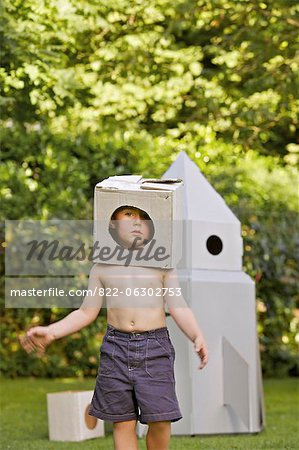 Boy Wearing Homemade Cardboard Helmet Playing in front of Rocket Spacecraft Stock Photo - Rights-Managed, Image code: 822-06302753