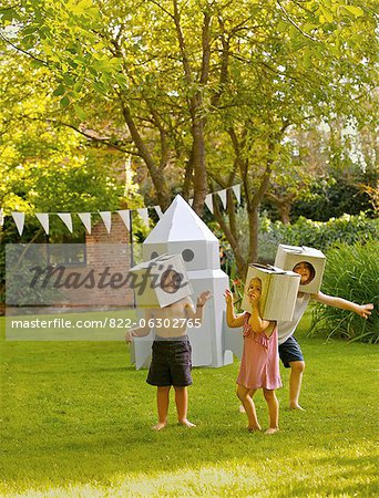Children Wearing Homemade Cardboard Helmets Playing around Rocket Spacecraft Stock Photo - Rights-Managed, Image code: 822-06302765