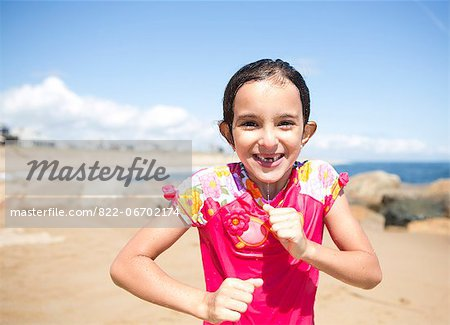 Portrait of Smiling Girl on Beach Stock Photo - Rights-Managed, Image code: 822-06702174