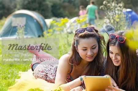 Teenage Girls Lying on Grass Using Tablet Stock Photo - Rights-Managed, Image code: 822-06702180