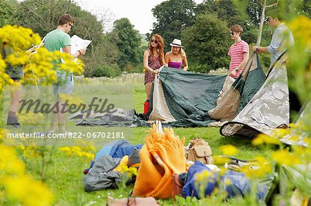 Group of Teenagers Erecting Tent Stock Photo - Rights-Managed, Image code: 822-06702181
