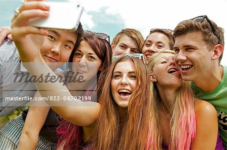 Group of Teenagers Taking Self Portrait Photo at Music Festival Stock Photo - Rights-Managed, Image code: 822-06702199