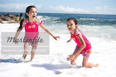 Twin Girls in Matching Outfits Playing on Beach Stock Photo - Rights-Managed, Image code: 822-06702211