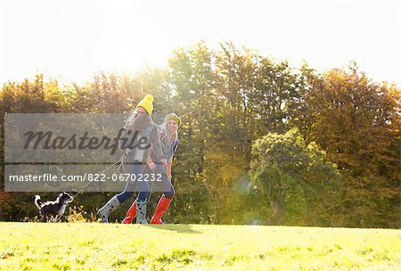 Mother and Daughter Running in Park with Dog Stock Photo - Rights-Managed, Image code: 822-06702232