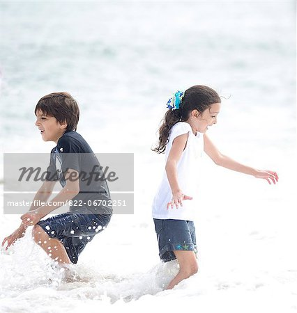 Boy and Girl Playing in Sea Water Stock Photo - Rights-Managed, Image code: 822-06702251
