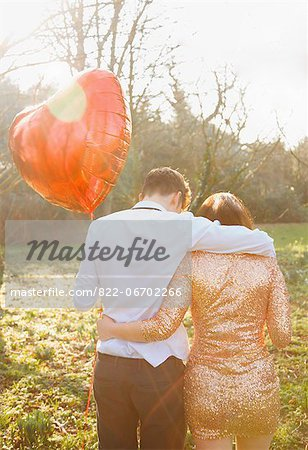 Couple in Park Holding Heart Shaped Balloon, Back View Stock Photo - Rights-Managed, Image code: 822-06702266