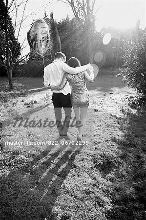 Couple in Park Holding Heart Shaped Balloon, Back View Stock Photo - Rights-Managed, Image code: 822-06702299