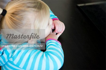 Girl Resting Head on Table Stock Photo - Rights-Managed, Image code: 822-06702472