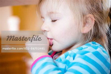Girl Sucking Thumb Stock Photo - Rights-Managed, Image code: 822-06702481