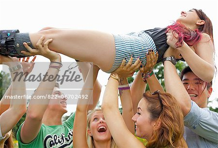 Teenagers Crowd Surfing at Music Festival Stock Photo - Rights-Managed, Image code: 822-06702492