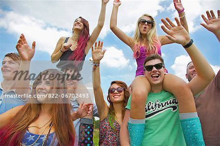 Group of Teenagers Cheering at Music Festival Stock Photo - Rights-Managed, Image code: 822-06702493