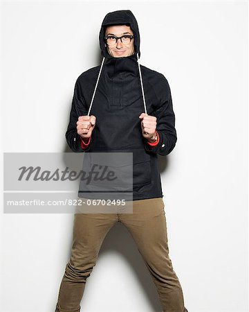 Man Adjusting Hooded Jacket Stock Photo - Rights-Managed, Image code: 822-06702495
