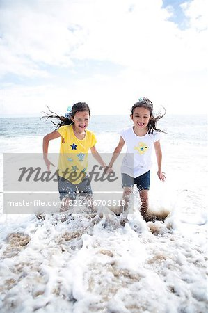 Twin Girls Playing in Sea Water Stock Photo - Rights-Managed, Image code: 822-06702519