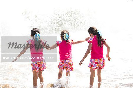 Back View of Girls in Matching Outfit Walking into the Sea Stock Photo - Rights-Managed, Image code: 822-06702559