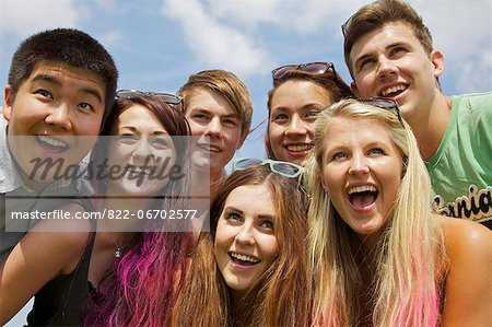 Group of Teenagers Cheering at Music Festival Stock Photo - Rights-Managed, Image code: 822-06702577
