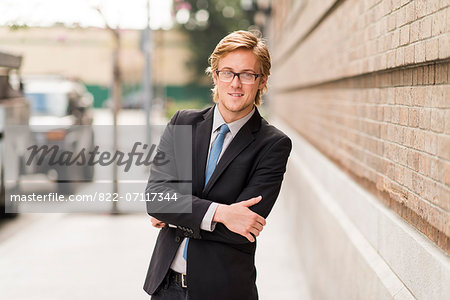 Businessman on Street with Arms Crossed Stock Photo - Rights-Managed, Image code: 822-07117344