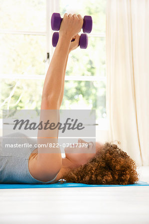 Woman Lifting Dumbbells Stock Photo - Rights-Managed, Image code: 822-07117379