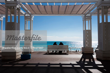 Two Women in Burka Sitting on Bench by Sea Stock Photo - Rights-Managed, Image code: 822-07117387