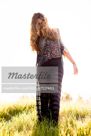 Woman Walking in Field Stock Photo - Rights-Managed, Image code: 822-07117401