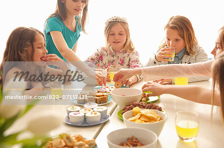 Group of Girls Eating and Drinking Around Table Stock Photo - Rights-Managed, Image code: 822-07117411