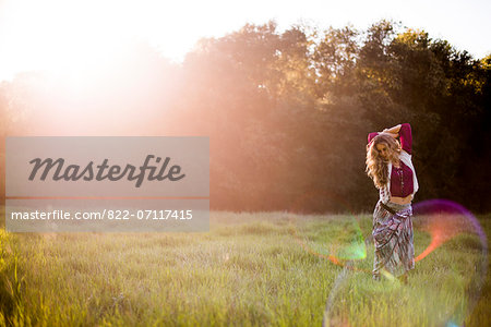 Woman Standing in Field Stock Photo - Rights-Managed, Image code: 822-07117415